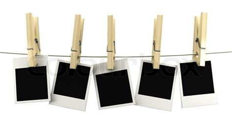 retro photo frame hanging on a rope on wooden clothespins stock photo colourbox