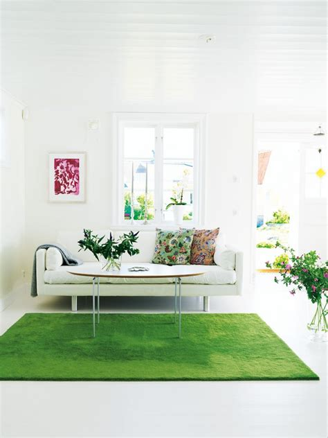 green living room rug is in the air vintage vibe