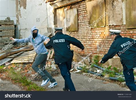 Can I Become A Officer With A Criminal Record Officers Are Chasing A Criminal Stock Photo 112401428