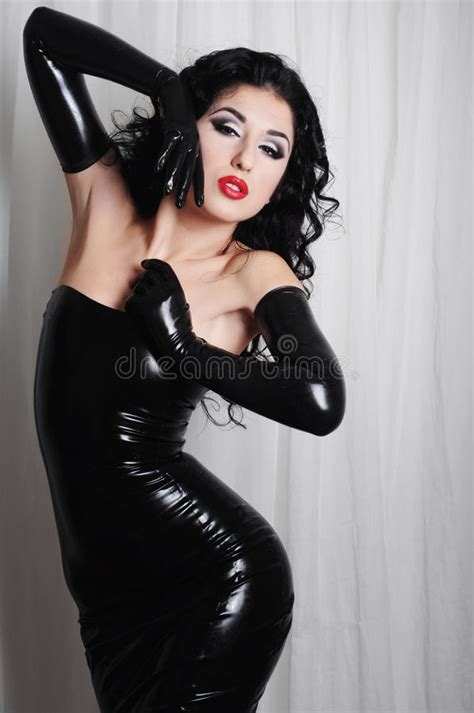 curling hair mistress mistress wearing long black latex gloves stock photo