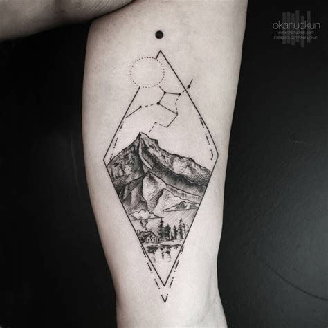 small tattoo man landscape on the left inner arm artist