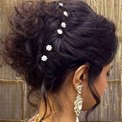 indian bridal hairstyle hair bun   Indian bridal