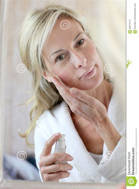 related keywords suggestions for middle aged beauty beautiful middle aged woman with cream stock photography