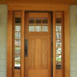 cherry entry door accented by craftsman hardware