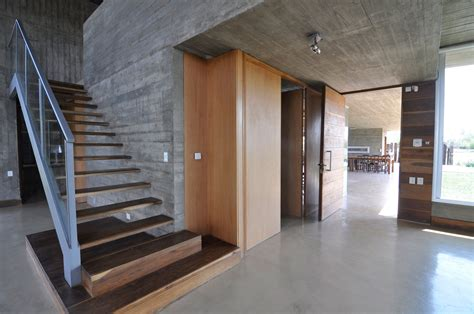 Exposed Concrete Interior by Km House Designed By Estudio Pablo Gagliardo Keribrownhomes