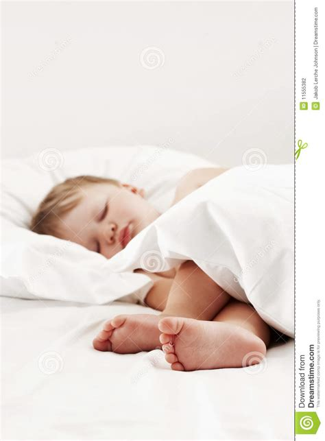 baby sleeping in bed baby sleeping in white bed stock photography image 11555382