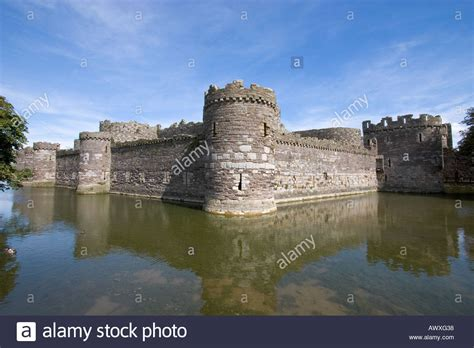 curtain wall of a castle south west corner of outer curtain wall and moat beaumaris