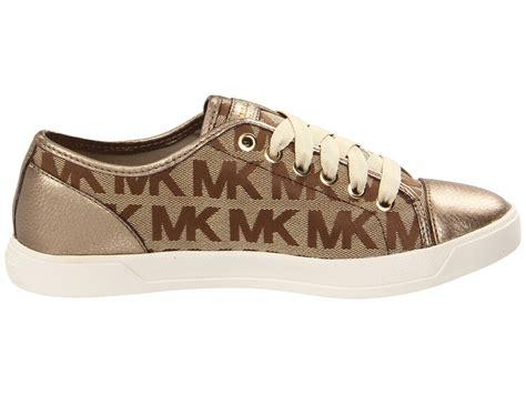 kors sneakers lyst michael michael kors mk city sneaker in brown
