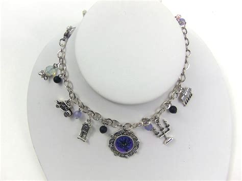 disney jewelry the haunted mansion charm bracelet geeky