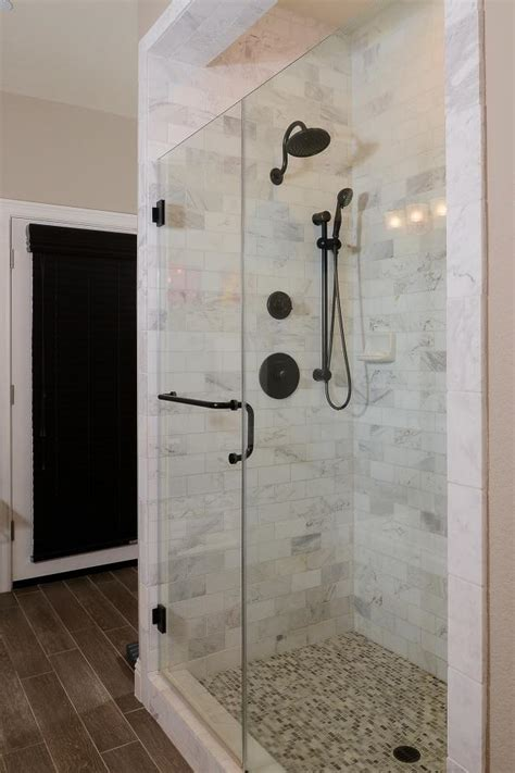 Timeless Glass Enclosed Shower With Marble Tile   HGTV