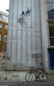 Bathroom Stencils Banksy S New Mayfair Mural Shows Woman Falling While