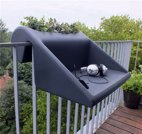 hang out on the balcony with combo planter and table