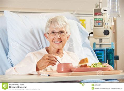 eating in bed senior female patient eating meal in hospital bed royalty