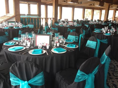 reception chair rentals marina venue black linens with turquoise napkins