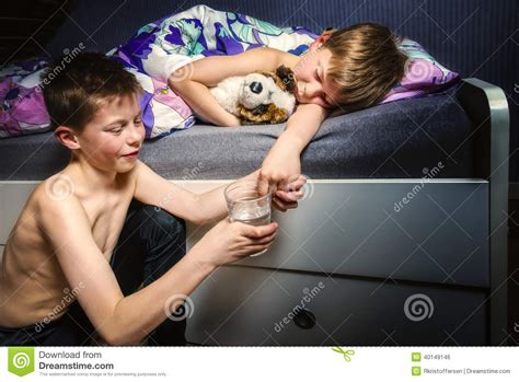how to wet the bed boy trying to make his brother wet the bed stock photo