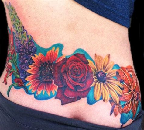 human canvas tattoos feminine flowers