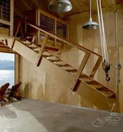 home inspiration stories one place garage stairs loft all made from recycled wood check out more this house here
