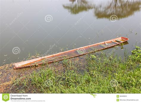 sinking rowboat old wooden rowboat sinking in natural lake stock image