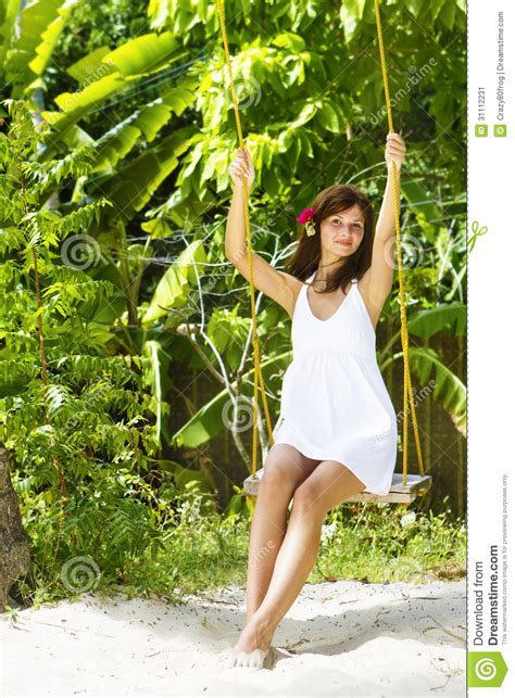 swinging naturals young beautiful woman swinging stock image image 31112231