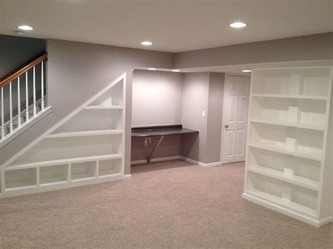 basement remodel built in storage under stairs shelves