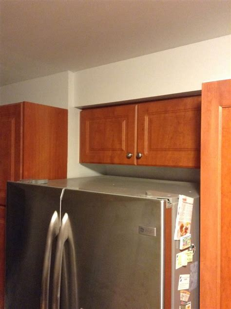cabinet above fridge how can i fix my shallow above fridge cabinet