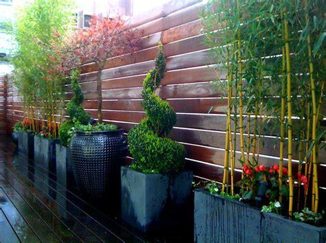 tribeca roof garden deck bamboo fence container garden terrace planters po contemporary