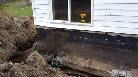 foundation sinking in one corner old cracks are sealed in caledonia mi home
