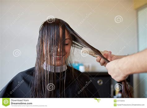 hair guard for cutting women hair happy woman with stylist cutting hair at salon stock photo