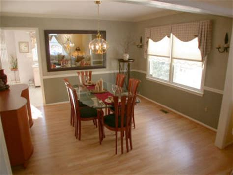 dining room on hardwood floors chair rail and crown moldings and two tone paint s board