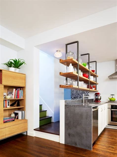 shelving hanging from the ceiling this home in brooklyn