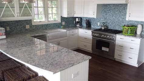 Colonial Granite With White Cabinets by Colonial White Granite Kitchen Craftsman With Chandelier