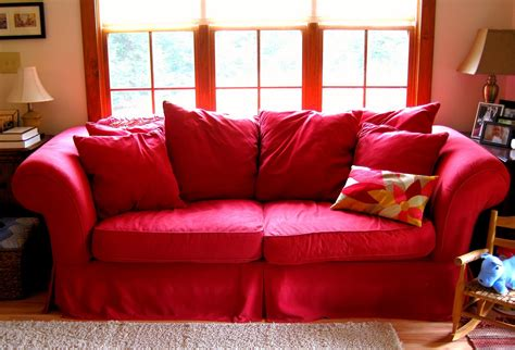 red couch covers the space between ode to the red couch