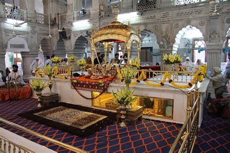 a bowing in respect to shri guru granth sahib darbar sahib