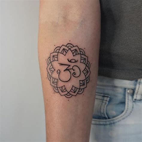 dark sign tattoo thin black hinduism special symbol in flower forearm