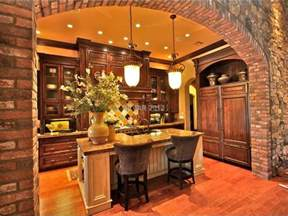 Tuscan kitchen with pendant lights and stone arch the
