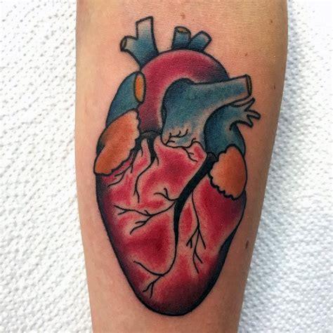 heart tattoos guys 90 anatomical heart tattoo designs for men blood pumping ink