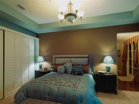 transitional style bedroom in brown with blue a bold elegant blue and chocolate brown bedroom designers