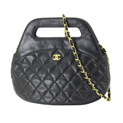 chanel black lambskin quilted gold chain top handle
