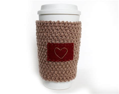 free knitting pattern coffee cup sleeve knitted coffee cup cozy sleeve orange with coffee