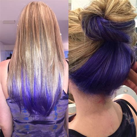 lowlighting the hair under the top layer bright purple blue peeks out underneath blonde highlights