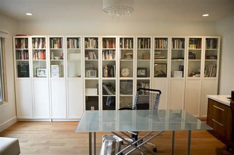 ikea billy bookcase with glass doors in a simple