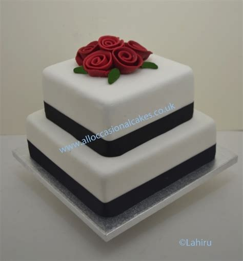 ruby rose and balck ribbon wedding cake 2 tier from £110