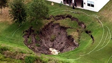 backyard sinkhole sinkhole swallows florida family s entire backyard