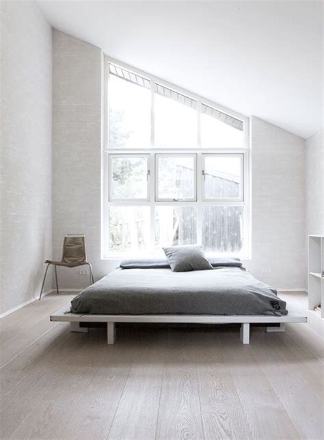 low headboard for window master bedroom evokes the vertical windows of the