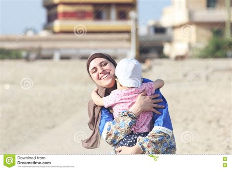 jinnealogy time islam and ecological thought in the ruins of delhi south asia in motion books baby wearing a cloth surrounded by a rainbow of