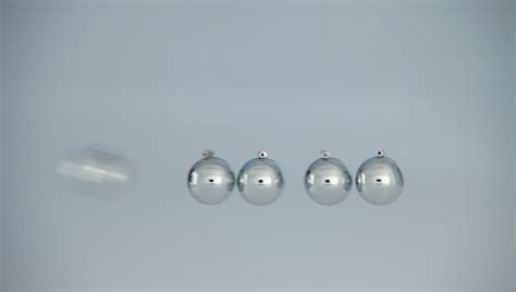 silver balls that swing back and forth newtons cradle pendulum stock footage video 11602241