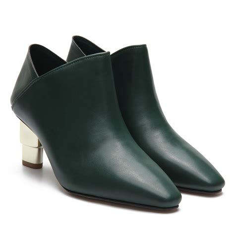 green leather look ankle boots with golden heel us 37 95