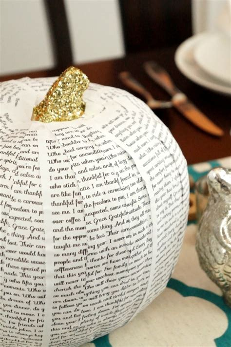 diy book page covered pumpkin