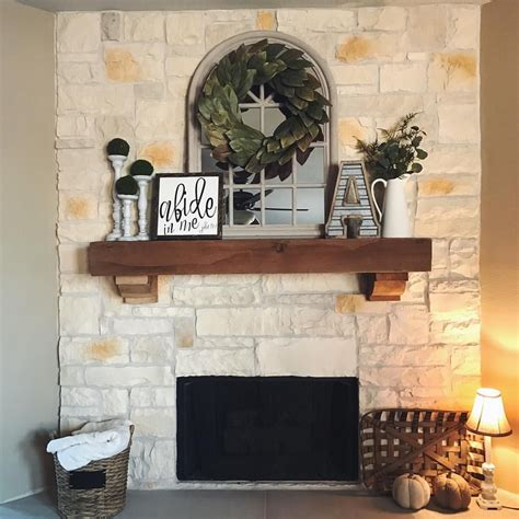 farmhouse mantel with magnolia wreath tobacco basket see