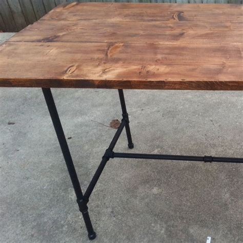 rustic dining table with industrial steel pipe by